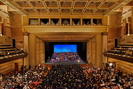 Doctoral Hooding Ceremony at Royce Hall filled graduates, faculty and guests