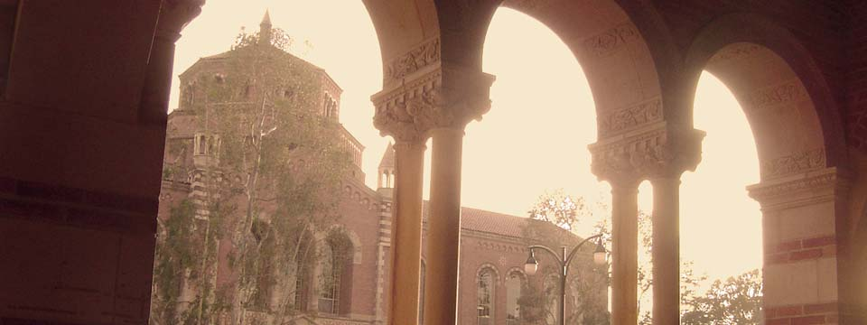 View looking out of Royce Hall through the arches.