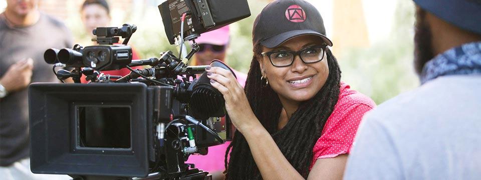 UCLA alum Ava Duvernay holds a camera