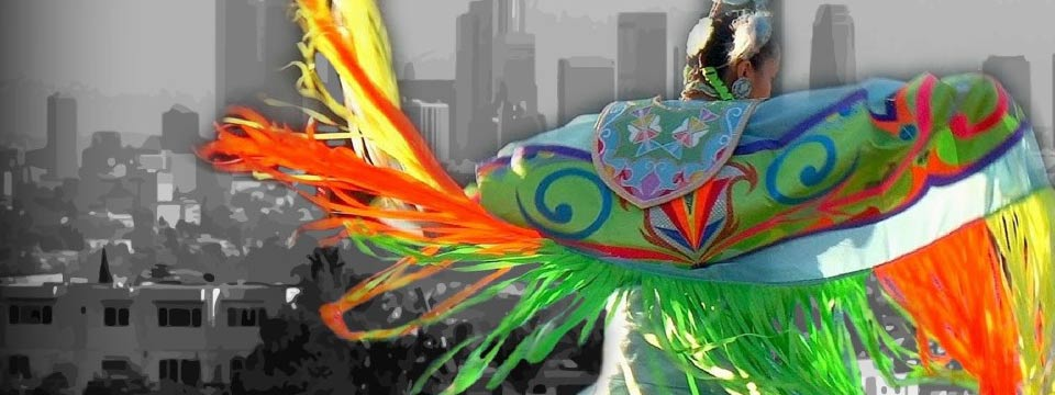 American Indian dancer with backdrop of Los Angeles