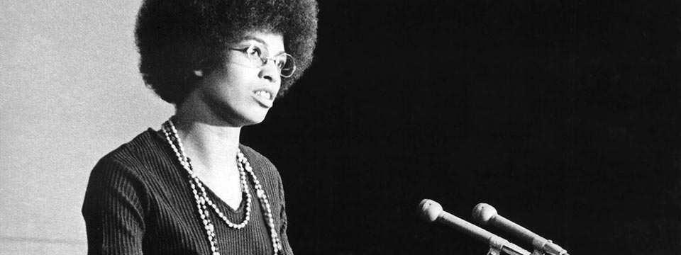 Black-and-white close-up of Angela Davis giving a lecture