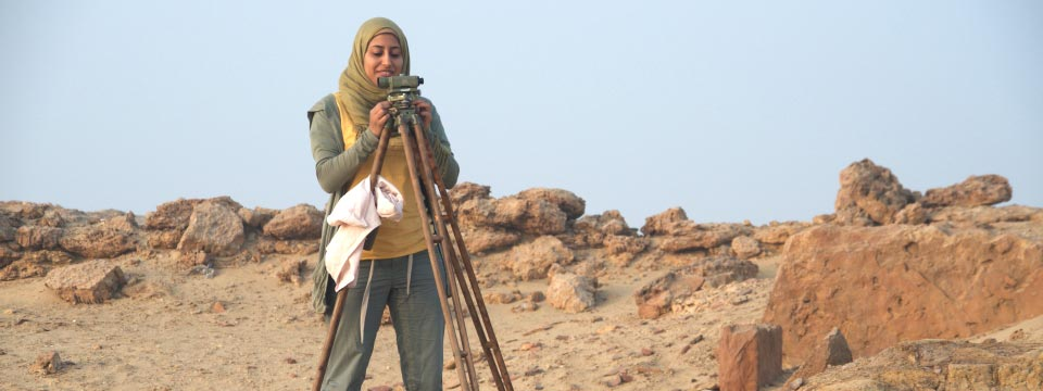 A woman does an archaeological survey