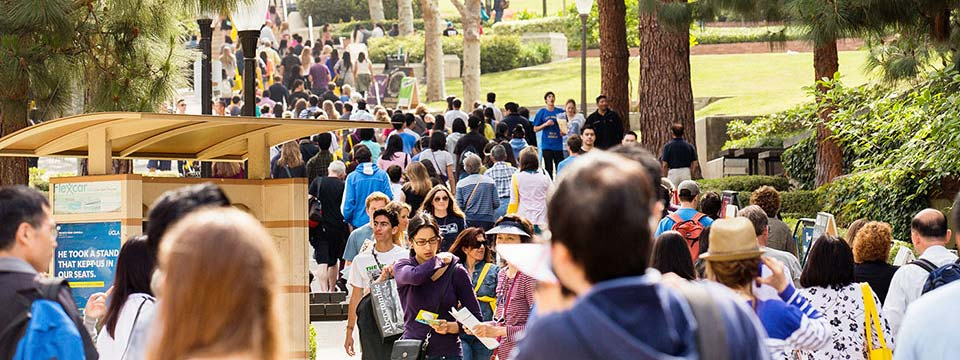 People gather down Bruin Walk on a crowded day