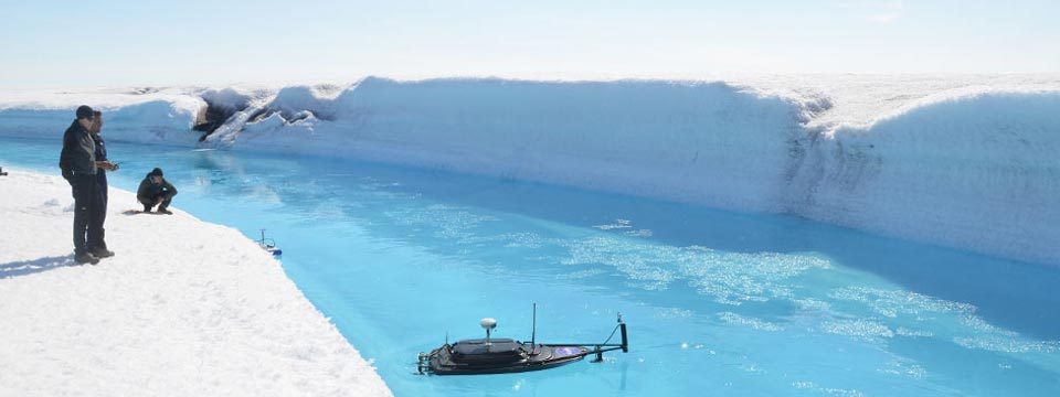 Dr. Lawrence Smith with a remote boat in Artic waters