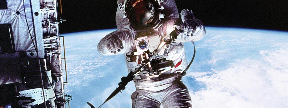 Person in a spacesuit, hovering over Earth