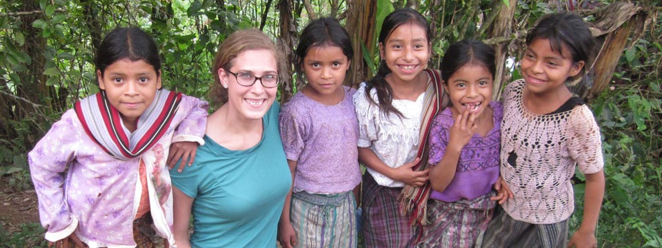 A student with young children in a tropical setting