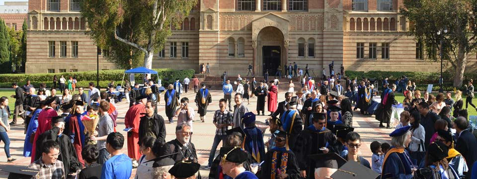 Graduates pose for photos outside of Royce Hall