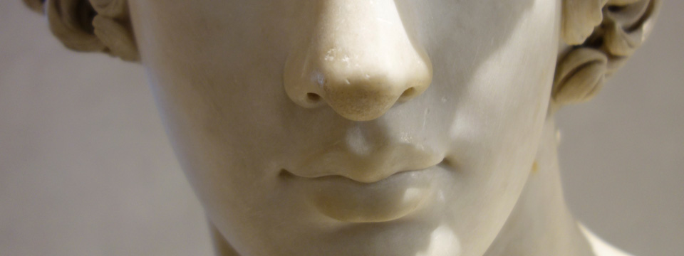Close-up of the nose and mouth of a statue