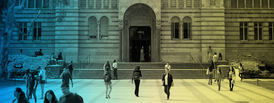 Students walk near the front steps of the Powell Library