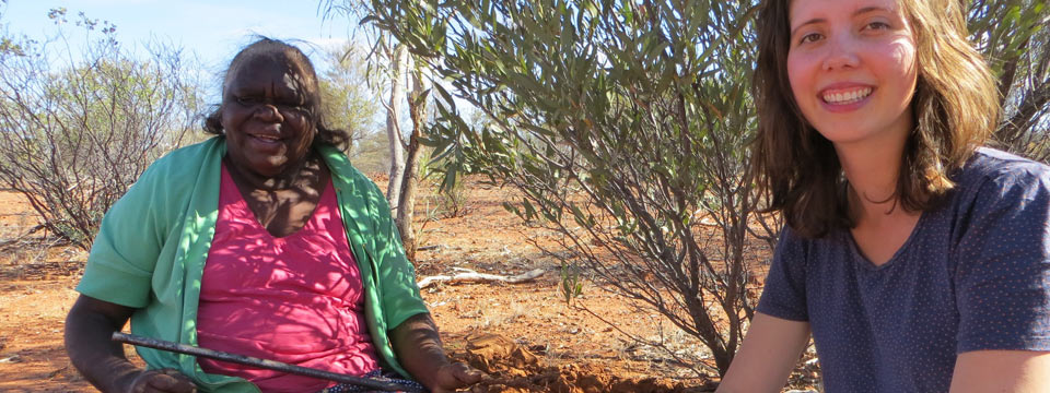 Graduate student Margit Bowler talks to a consultant in central Australia